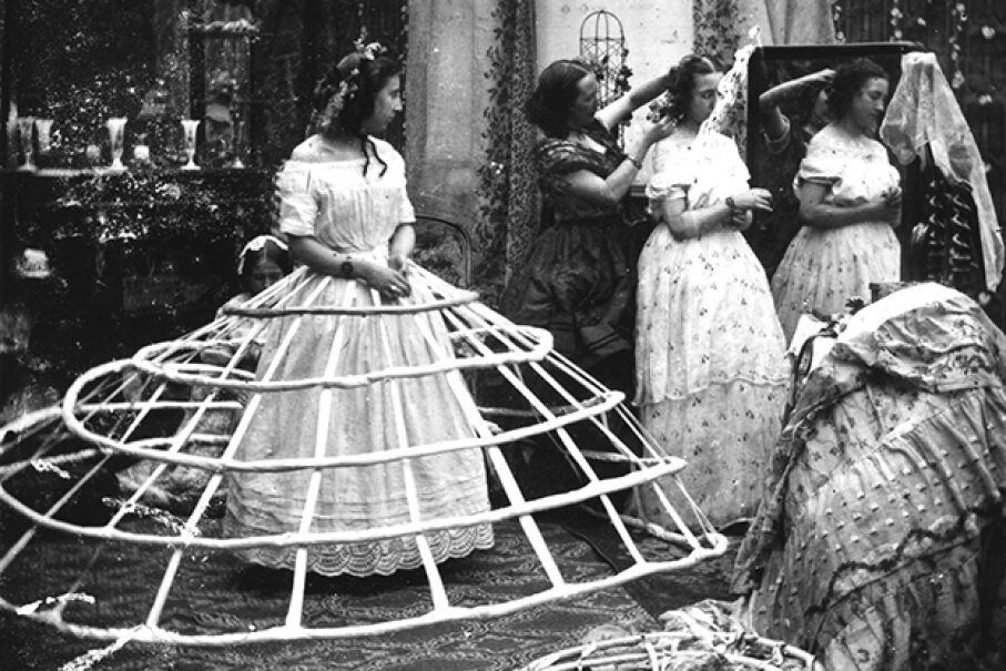 A crinoline-sporting woman waits for help before attempting to get dressed. London Stereoscopic Company/Getty Images