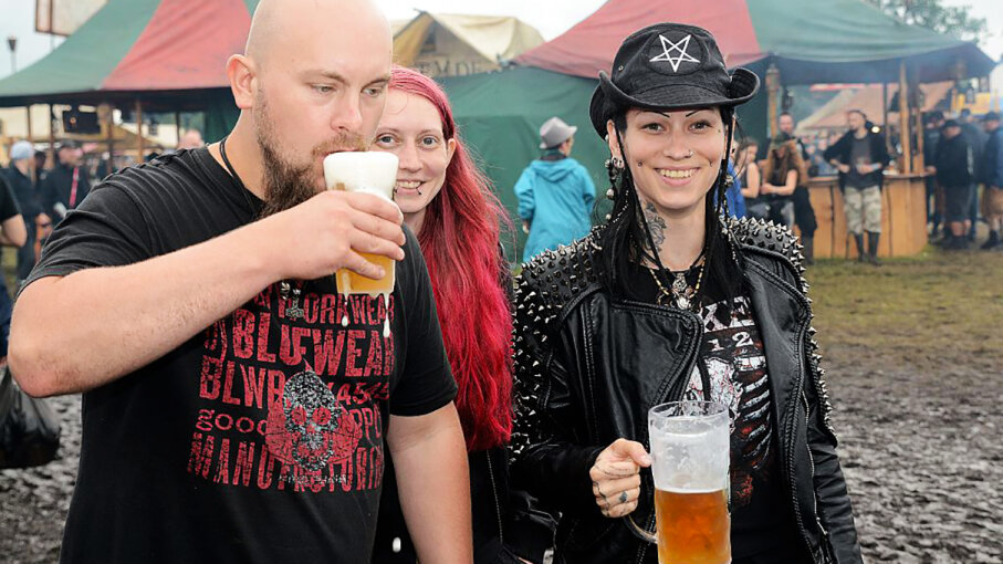 Festival visitors drink beer during the Wacken Open Air festival on Aug. 3, 2016, in Wacken, Germany. Didier Messens/Getty Images
