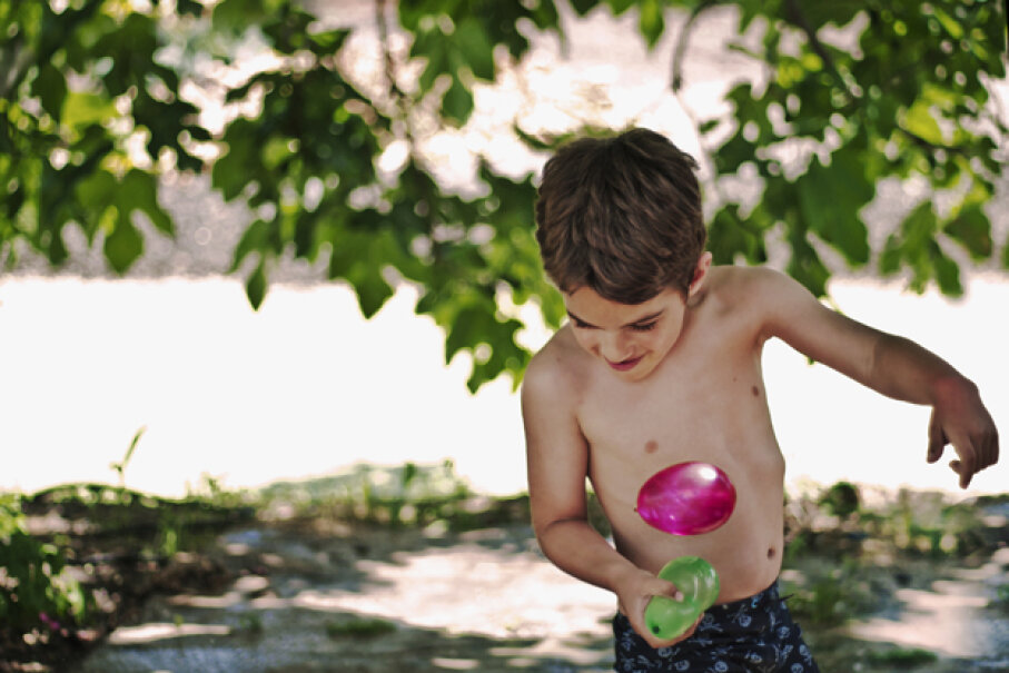 In a water balloon race, you have to get to the other side without breaking your balloon. elvira boix photography/Flickr/Getty Images