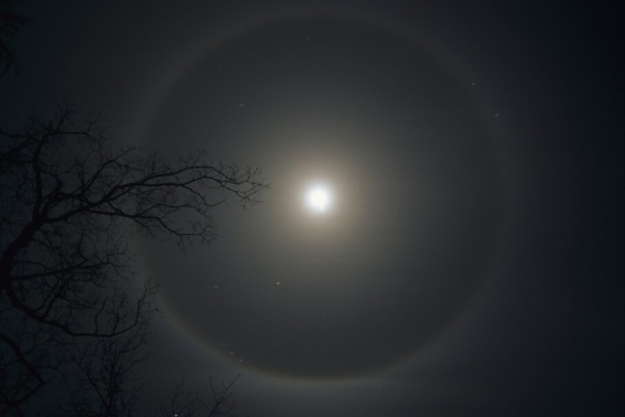 A halo encircles the moon, courtesy of some ice crystals. © Visuals Unlimited/Corbis