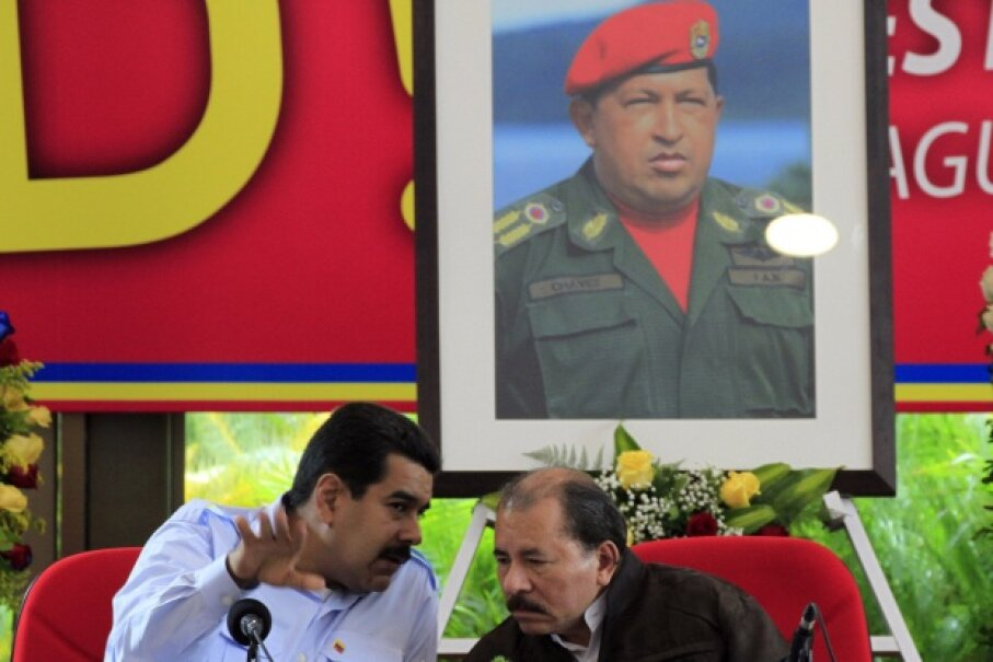 Yep, Chavez does kind of seem to be everywhere you go, Mr. President. Maduro (L) is talking with Nicaraguan President Daniel Ortega (R) in this June 30, 2013, pic while Chavez looks on from the picture above. © Oswaldo Rivas/Reuters/Corbis