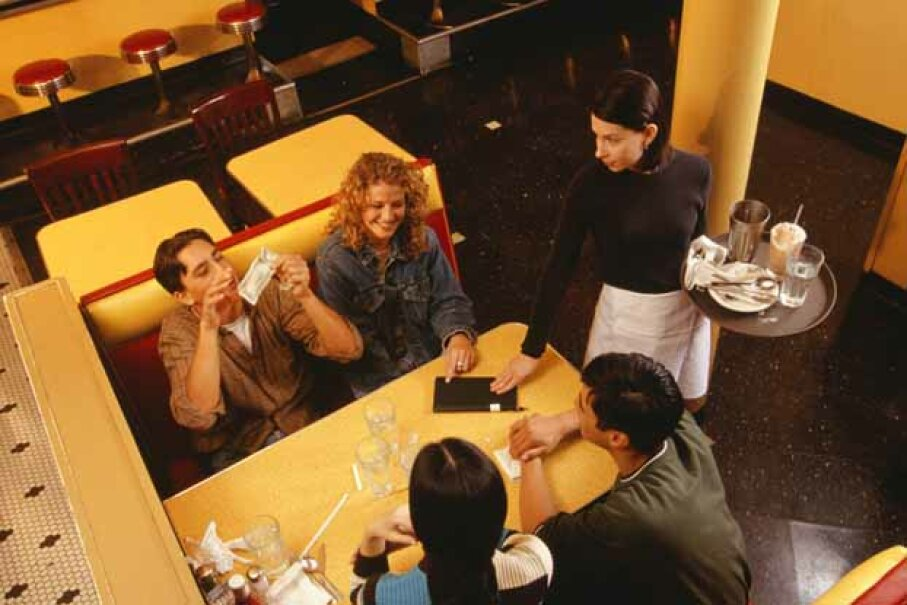 Bugging your friends to pay you their share of the restaurant bill might be a thing of the past, thanks to a Google patent. Doug Menuez/Photodisc/Thinkstock