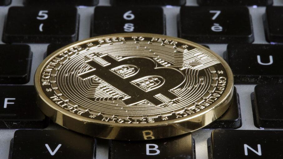 Bitcoin on computer keyboard