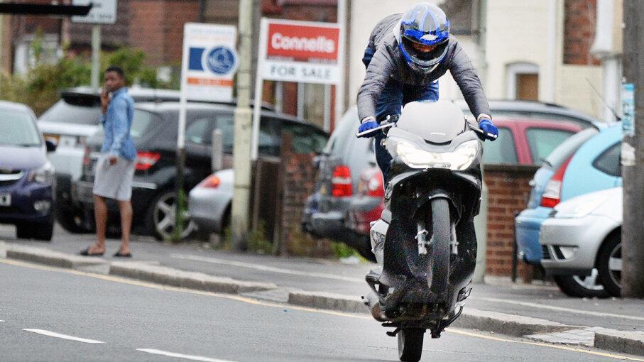 motorcyclist popping wheelie