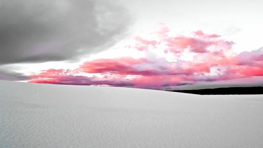 white sand dunes with pink clouds