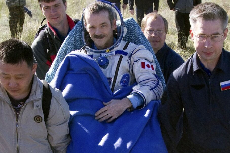 Canadian astronaut Chris Hadfield, seen here right after landing in May 2013, made quite the name for himself when he used the ISS's WiFi to tweet to his followers back on Earth. SERGEI REMEZOV/AFP/Getty Images
