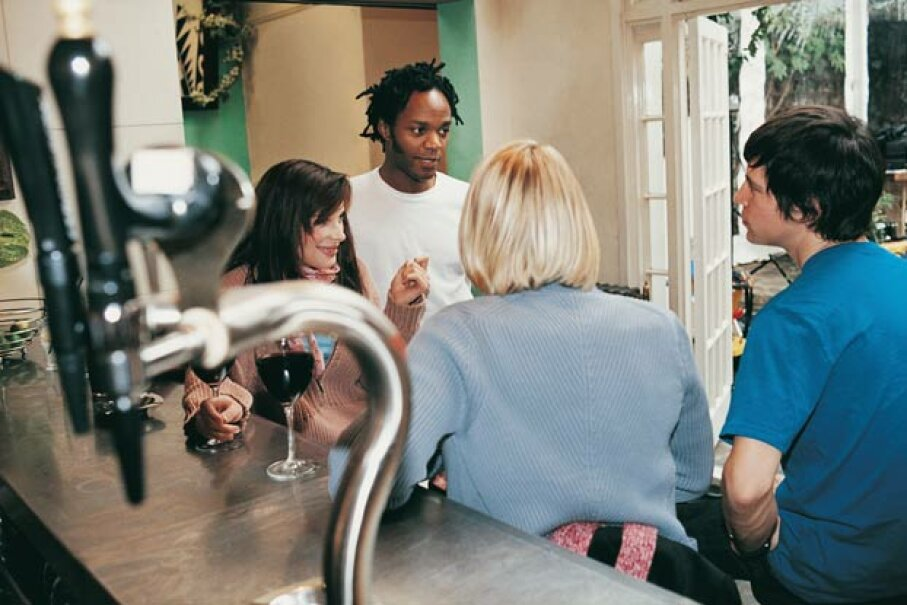 Lots of hip, urban areas have wine bars where patrons can taste or serve themselves tap wine. Digital Vision/Thinkstock