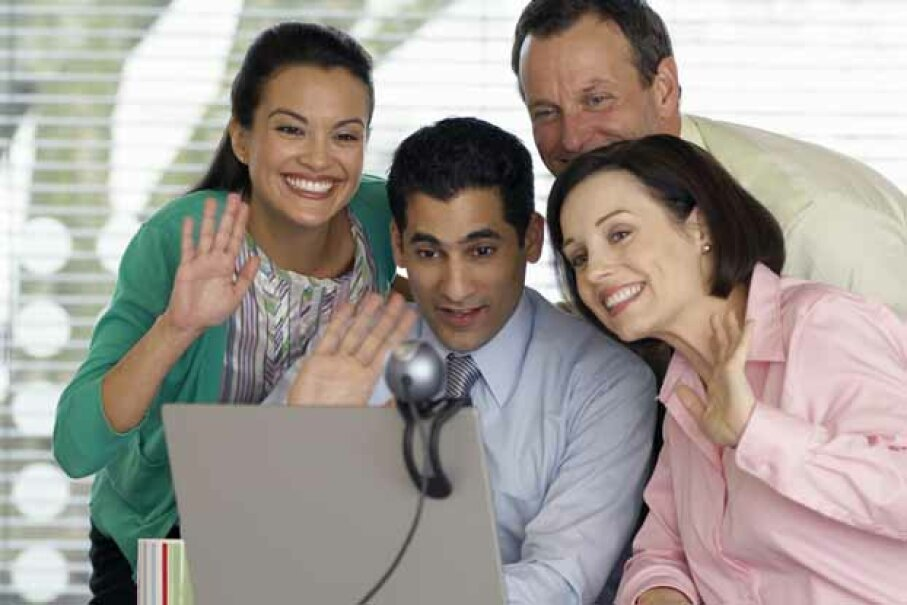 If you telecommute, say hello to the folks at the office on a regular basis. Fuse/Thinkstock