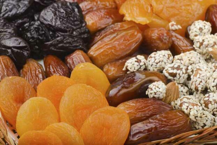 Stock up on nuts and dried fruit as well as crunchy vegetables to get through the snack attacks without gaining a ton. iStock/Thinkstock