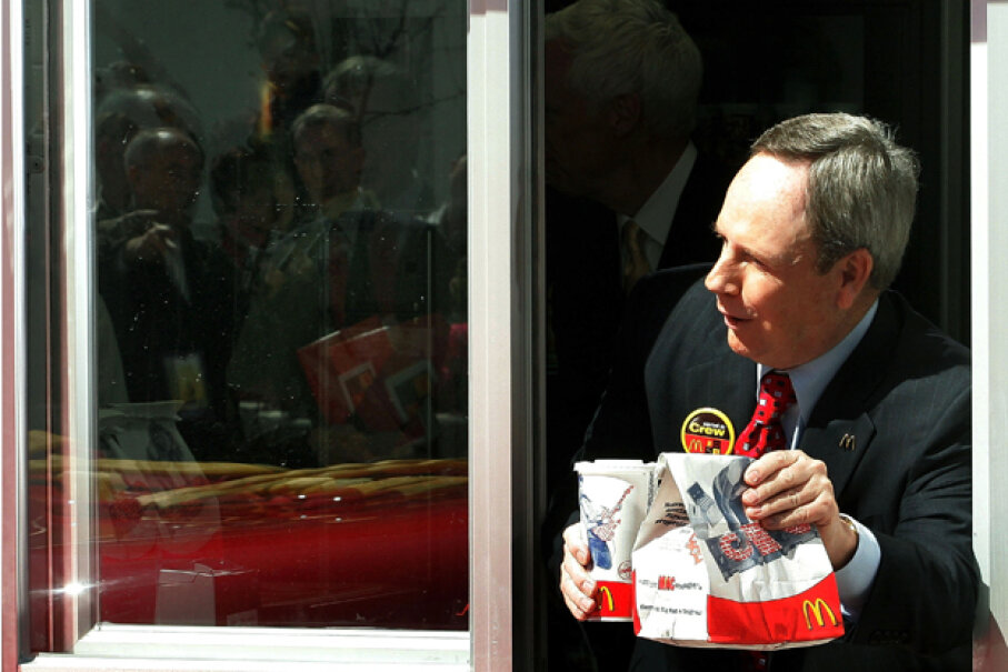 McDonald's CEO Jim Skinner is seen at the drive-through window during the celebration of the chain's 50th anniversary in Chicago, 2005. Let's hope he didn't cause any emergency calls for wrong orders. Tim Boyle/Getty Images
