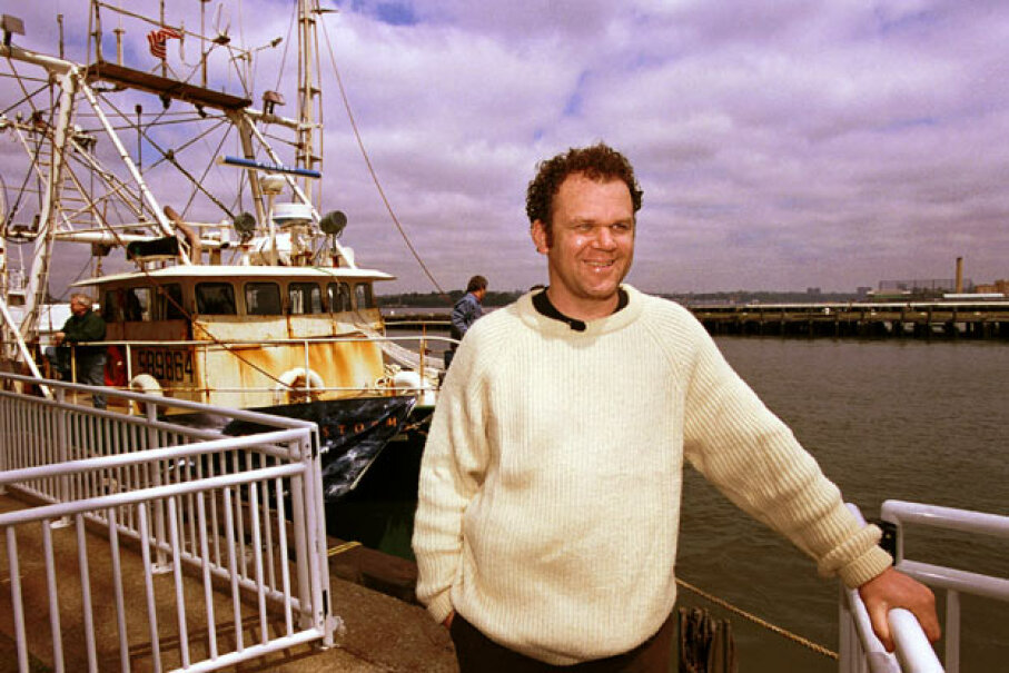 """Actor John C. Reilly, who appeared in the film """"The Perfect Storm,"""" poses in front of a replica of the doomed ship """"The Andrea Gail,"""" which went down in the Perfect Storm. Chris Hondros/Newsmakers/Getty Images"""