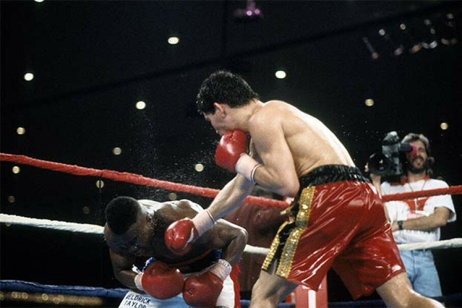 Meldrick Taylor (L) is hit with a punch from Julio Cesar Chavez during a fight at the Hilton Hotel in Las Vegas in 1990. The fight was called for Chavez with just two seconds remaining. See other sports pictures. The Ring Magazine/Getty Images