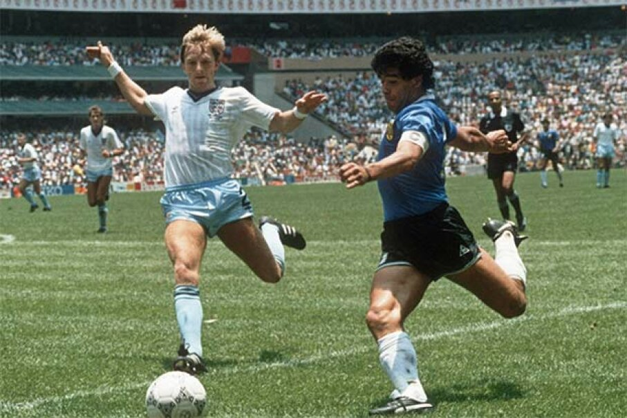 Argentinian forward Diego Maradona (R) readies to cross the ball under pressure from English defender Gary Stevens during the World Cup quarterfinal. This 1986 match is well-remembered for Maradona's 'hand of God' comment. STAFF/AFP/Getty Images