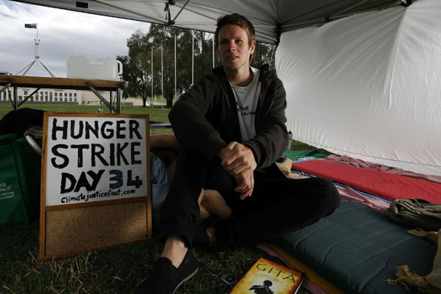 Protester Paul Connor sits on the lawns of Parliament House on day 34 of his hunger strike calling for climate change action, on Dec. 10, 2009, in Canberra, Australia. Stefan Postles/Getty Images
