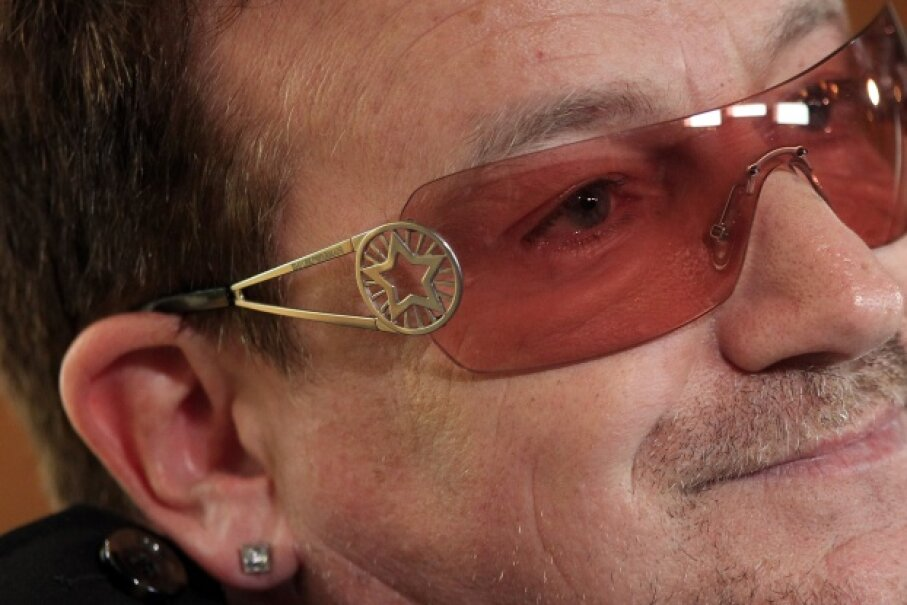 """Bono hangs out at the opening session of the 2012 Oslo Forum. Somehow he doesn't seem terribly concerned about that lyric in the song """"Pride (In The Name Of Love)."""" © Cathal Mcnaughton/Reuters/Corbis"""